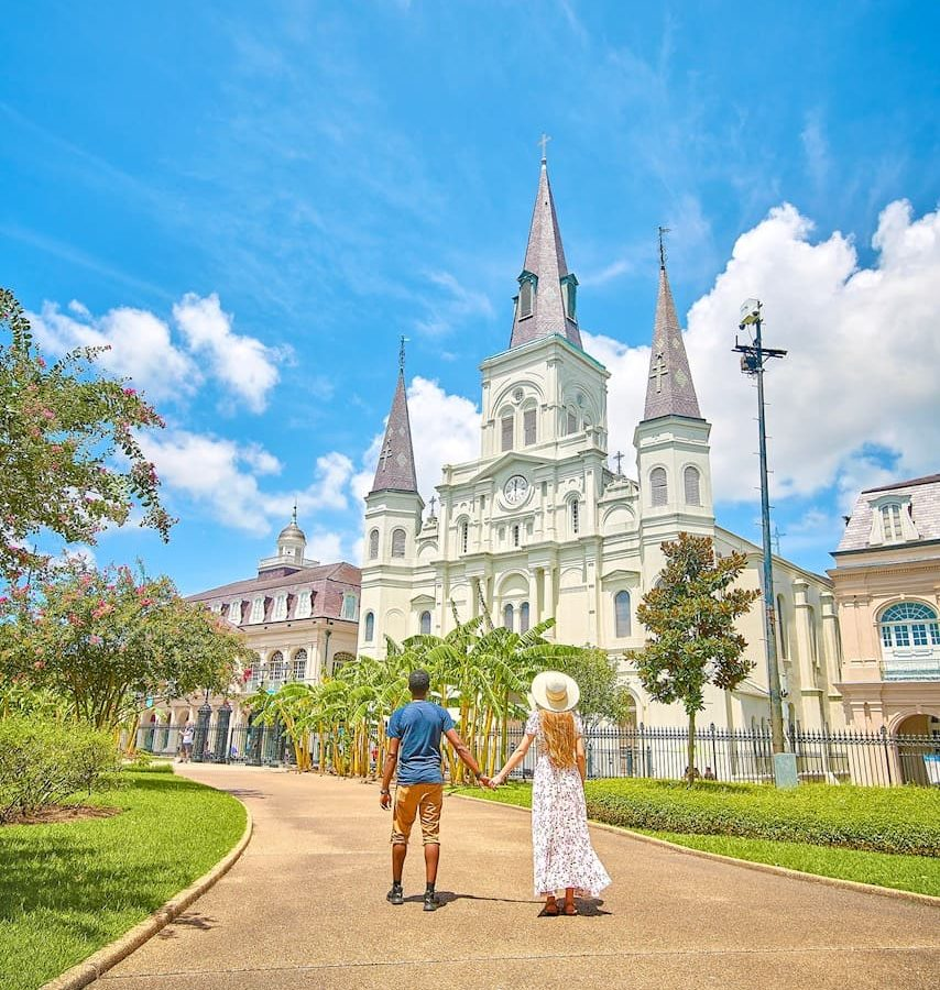 couple standing in front of church during their 3 days in new orleans getaway