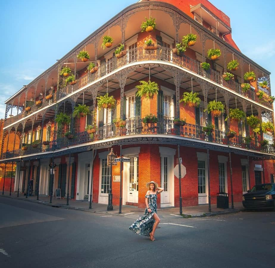 Girl standing on one of the prettiest streets in new orleans