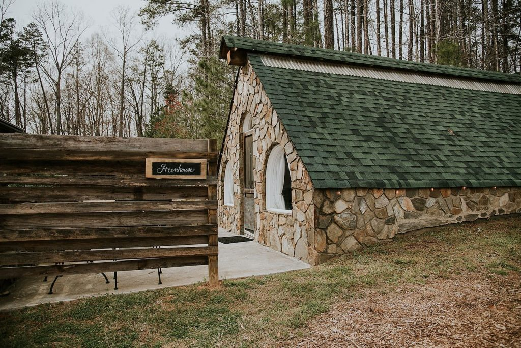 Photo of the outside of an elegant stone greenhouse North Carolina Airbnb.