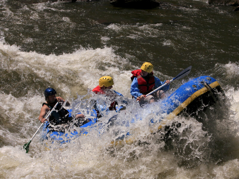 A family rides on a raft through rapids in Tennessee.