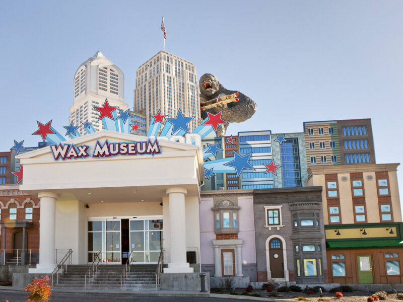 A towering wax figure of King Kong clings to the siding of The Wax Museum building in Pigeon Forge. The museum is designed to look like a city skyline.