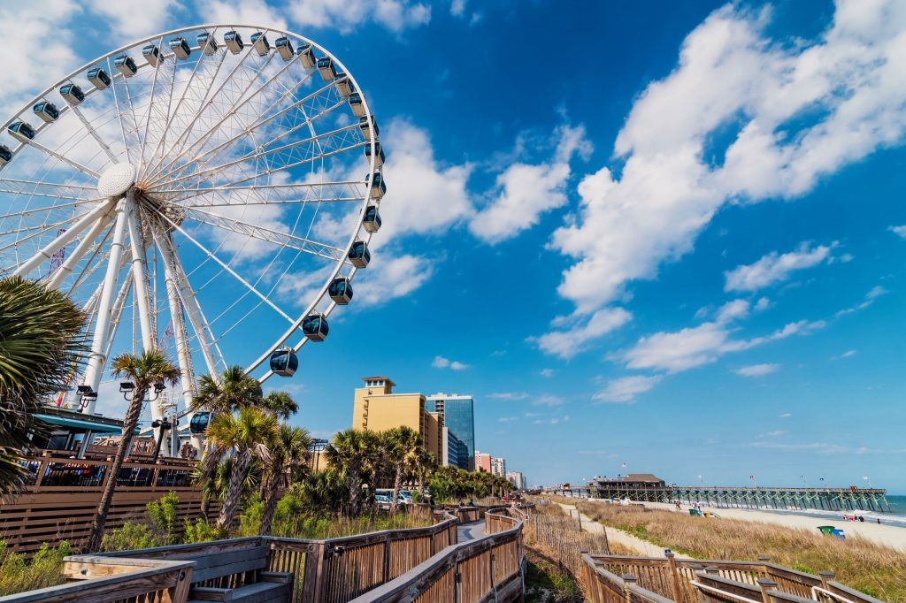 Photo of Myrtle Beach that includes the Skywheel and the beach.
