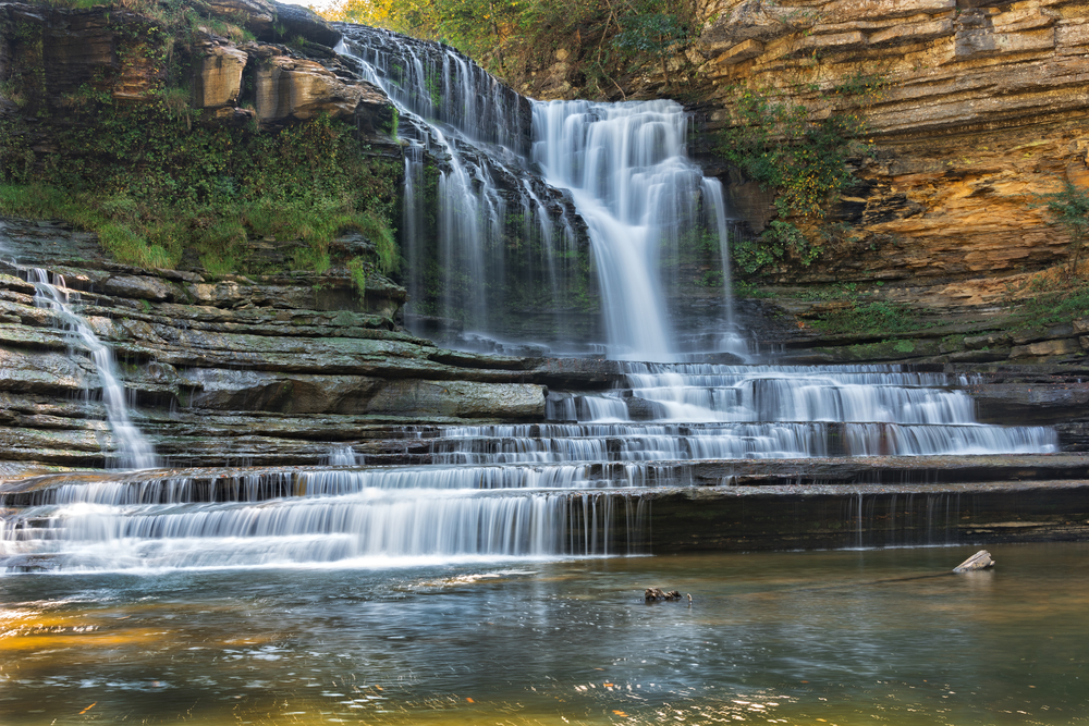 waterfall cascading down natural rock steps weekend getaways in Tennessee