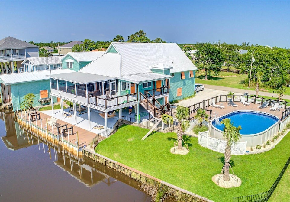 This is an amazing home on the water with private pools for large groups in Bay St. Louis Mississippi