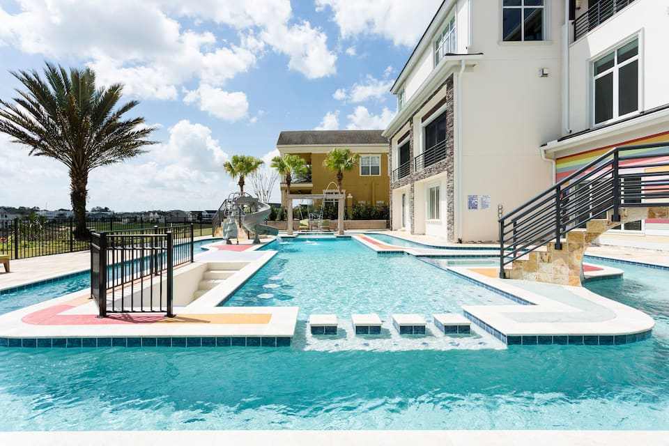 There is a rooftop pool and a private lazy river that goes around perfect for the relaxing under the Florida sun at this airbnb in Orlando Florida