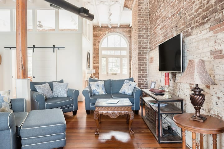 Come stay at this industrial riverfront condo for a dreamy place  to stay in Southern USA