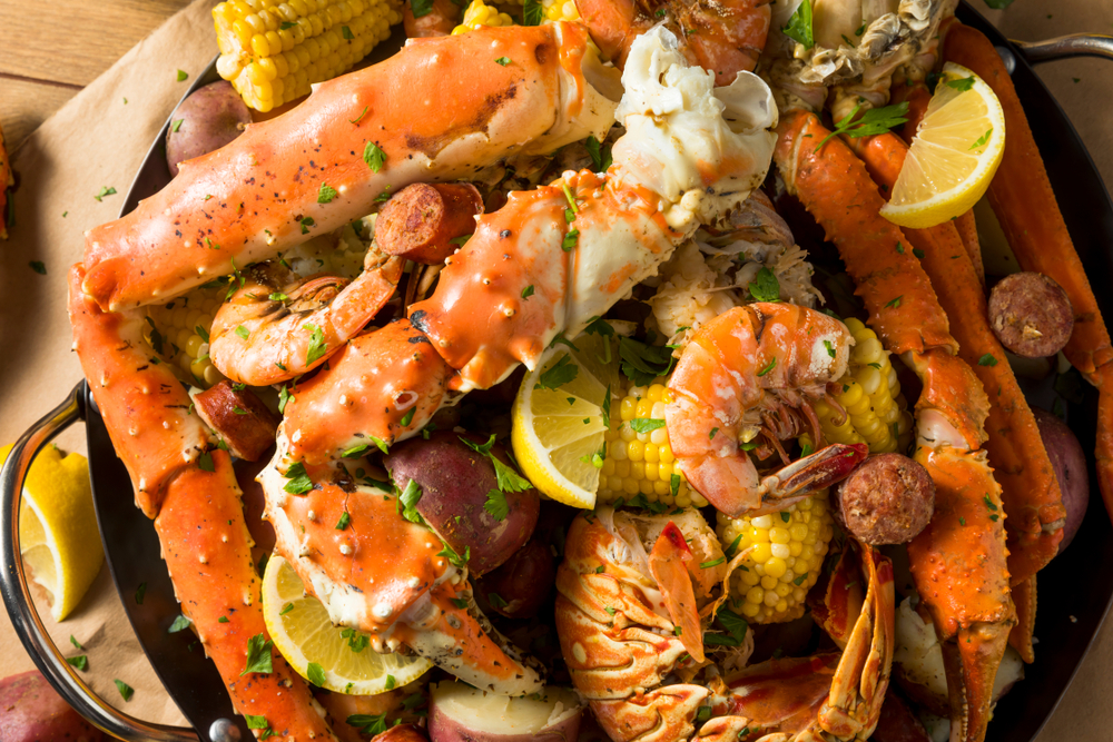 A crab boil like the one you can get at the Crab Shack that is full of crab, shrimp, potatoes, and corn