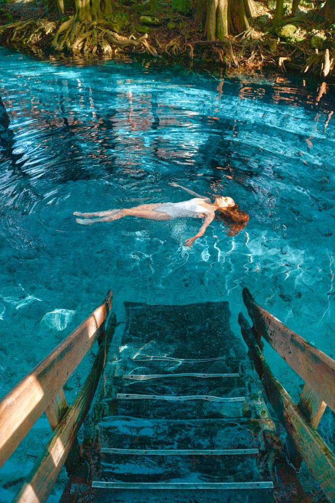 Victoria floats in the clear waters of Ginnie Springs.