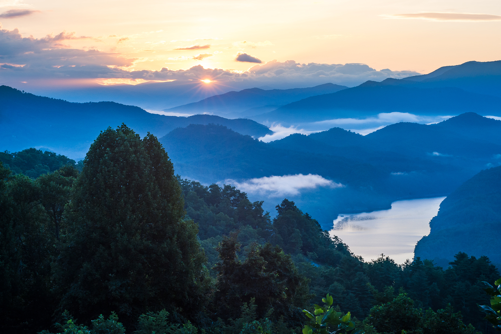 The Great Smoky Mountains at sunset in Tennessee one of the best stops on a Tennessee road trip