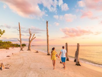 a couple walking on the beach in Lovers Key Florida one of the most romantic getaways in the South