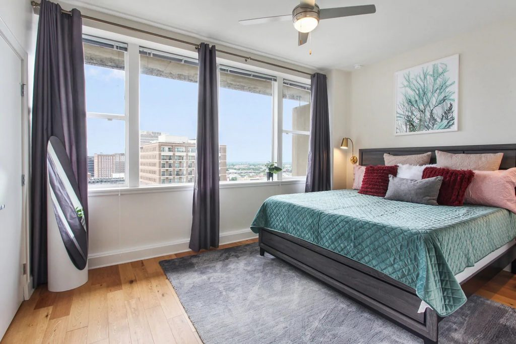 Photo of a penthouse Airbnb in New Orleans with city views from the bedroom.