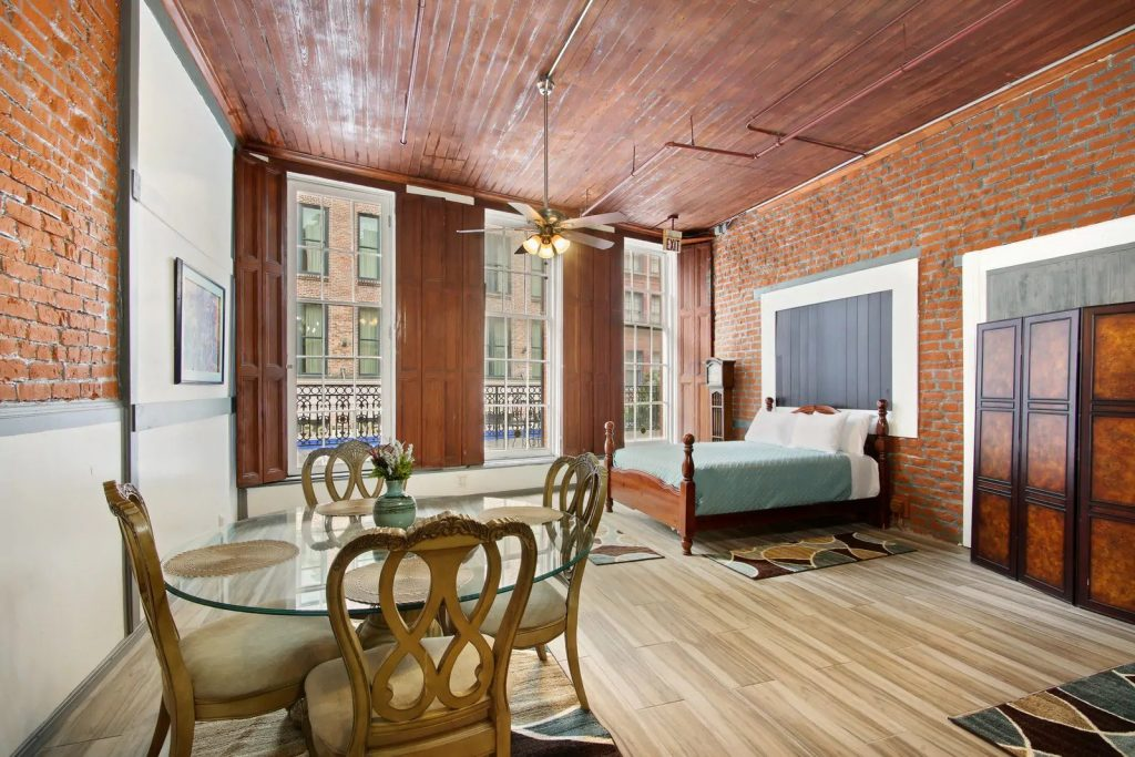 Photo of an Airbnb in New Orleans that is a downtown loft with hardwood ceilings.