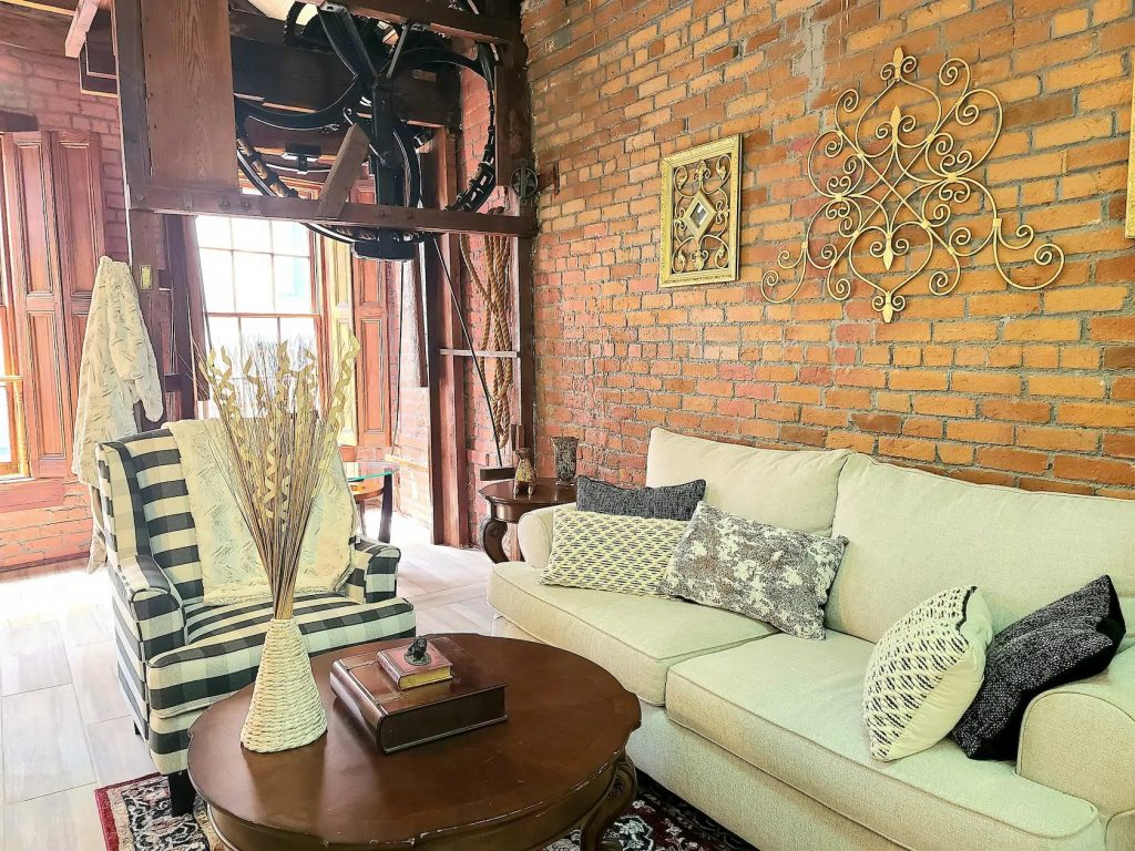 Photo of downtown penthouse Airbnb in New Orleans with 200 year old brick walls.