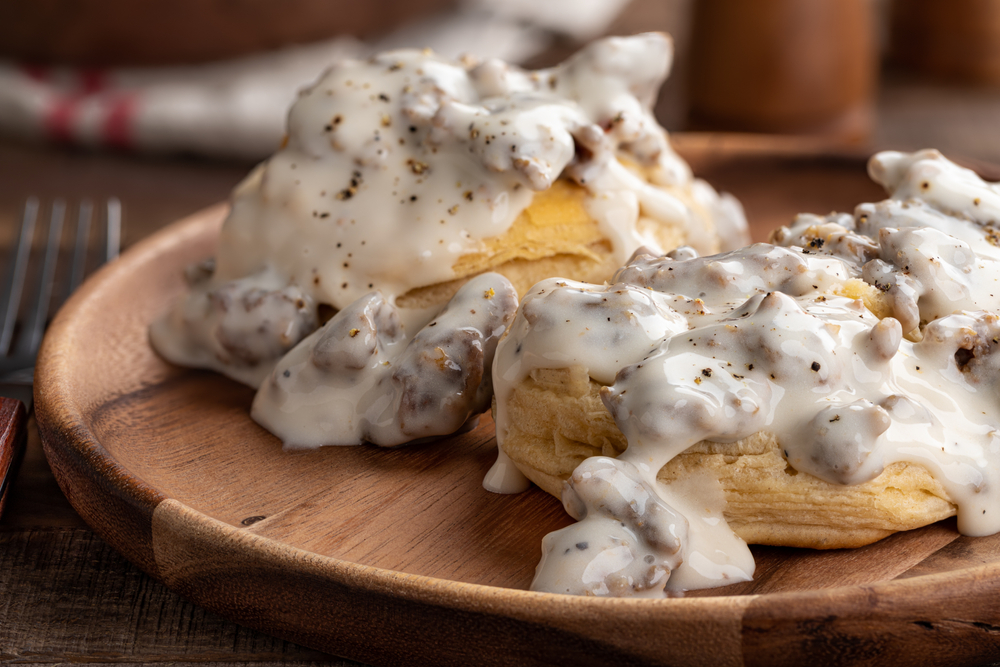 Photo of buttermilk biscuits topped with sausage gravy, a delicious choice for the best breakfast in Savannah.