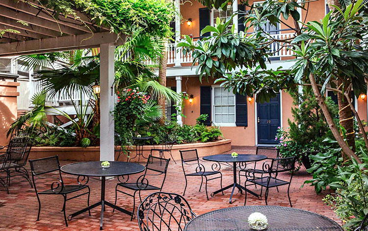 this bed and breakfast in charleston has a gorgeous outdoor pation