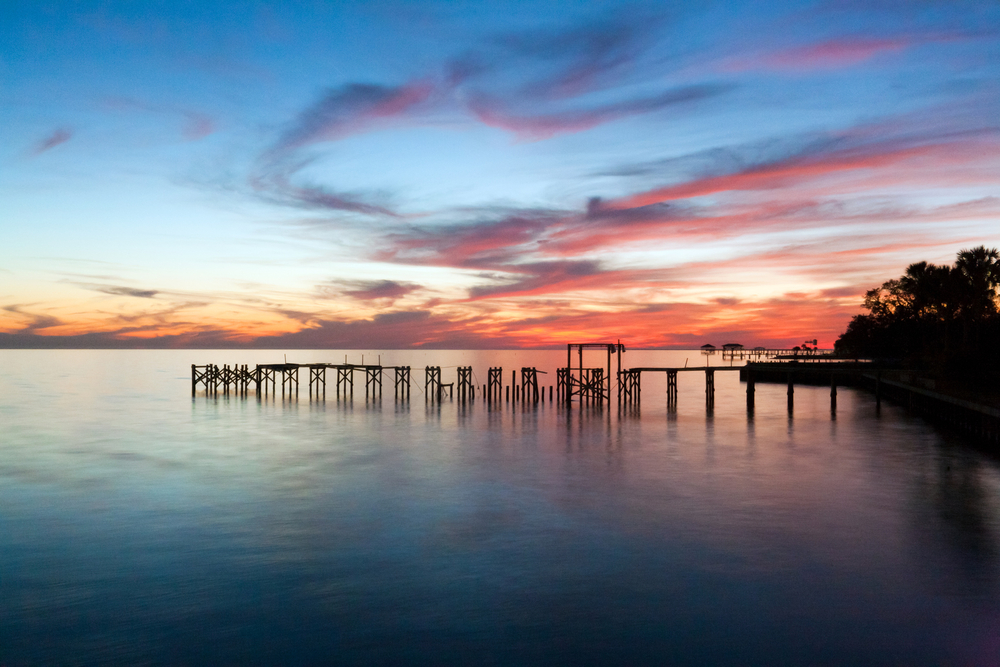 Pretty sunset over Lake Pontchartrain, something you can see on a weekend getaway in Louisiana.