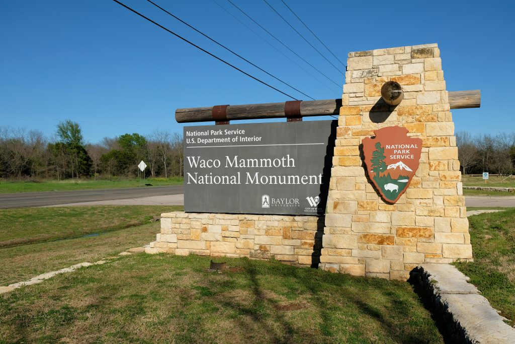 Photo of the sign welcoming visitors to Waco Mammoth National Monument