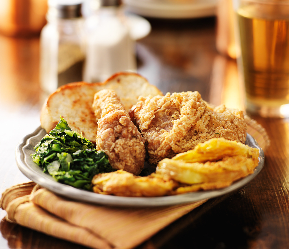 Photo of fried chicken with collard greens and toast, a classic southern meal that is offered at many restaurants in Savannah