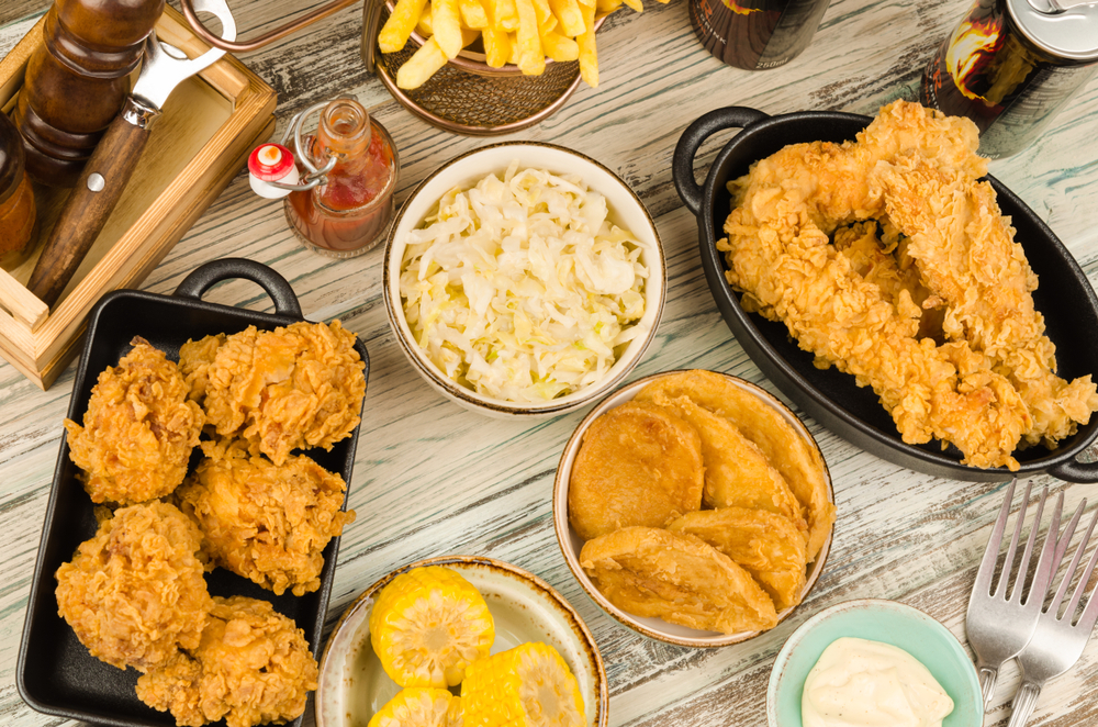 Photo of a classic southern meal of fried chicken and coleslaw served family style, a delicious option at many restaurants in Savannah