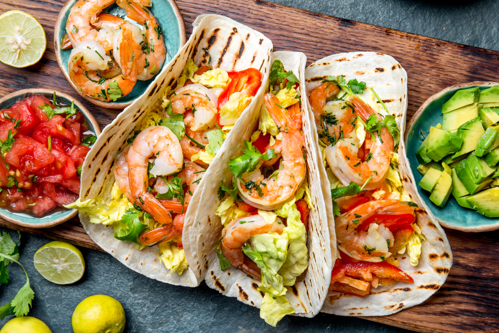Photo of shrimp tacos, a delicious meal to order at seafood restaurants in Savannah.