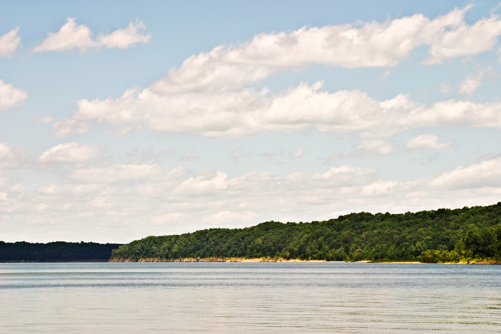 A photo of a clear and sunny day at Green River Lake State Park Beach.