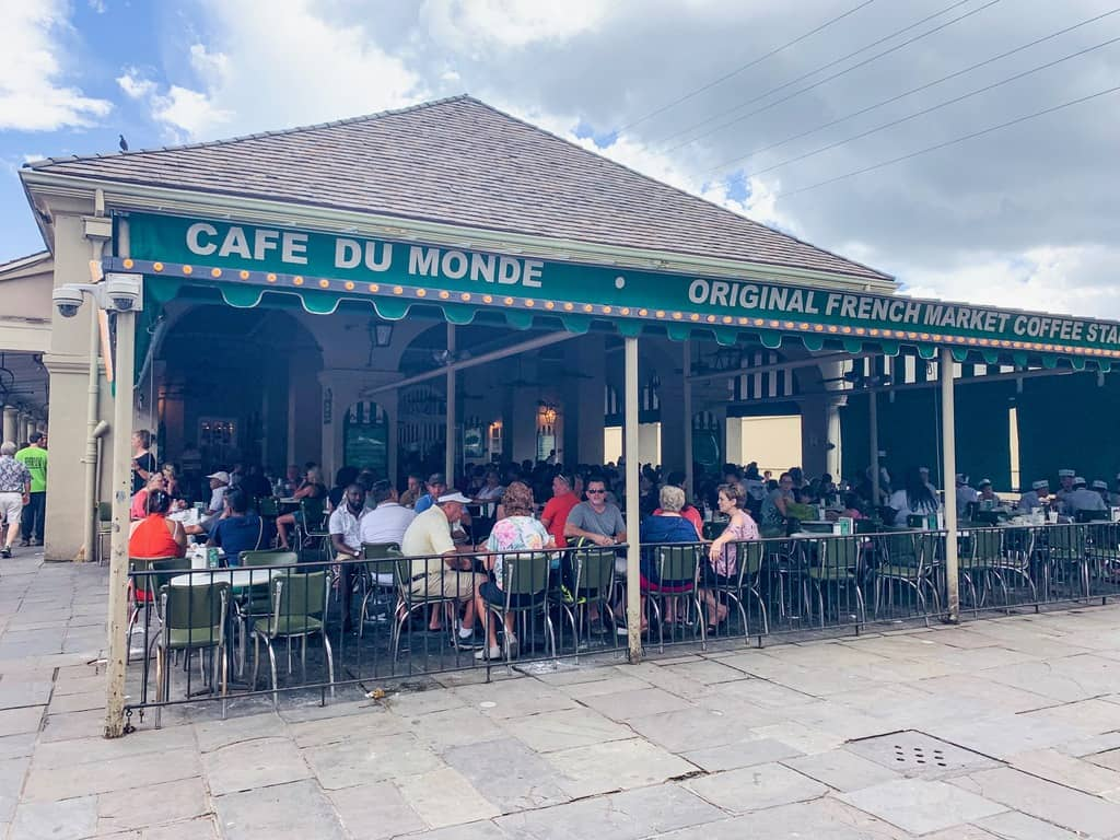 The outside of Cafe Du Monde in New Orleans a great place to grab breakfast at your New Orleans Bachelorette Party