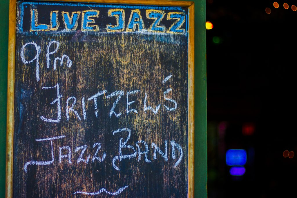 A chalk sign advertising live Jazz at Fritzel's European Jazz Pub in New Orleans