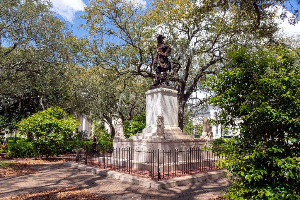Chippewa Square, shaded by trees, in Savannah, Georgia.