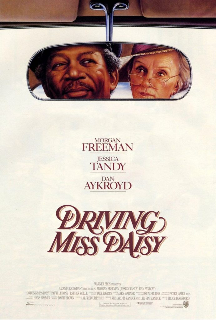 Morgan Freeman and Jessica Tandy are seen in a rearview mirror in the poster for Driving Miss Daisy