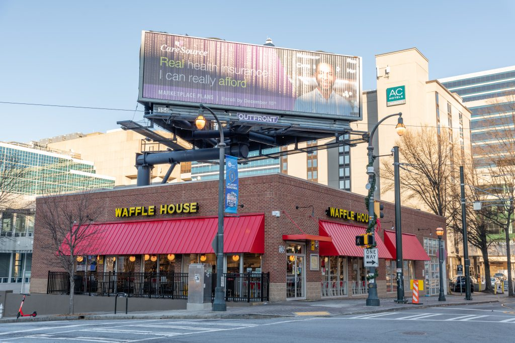 A Waffle House stands on a street corner in downtown Atlanta, Georgia