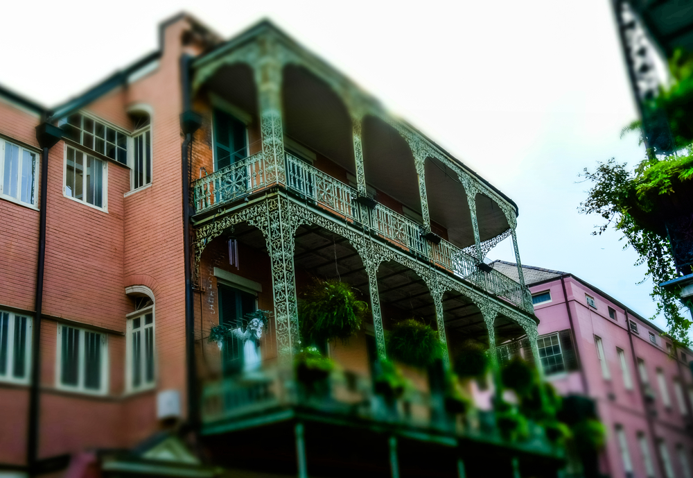 Ancient colonial mansions on Bourbon Street in New Orleans.