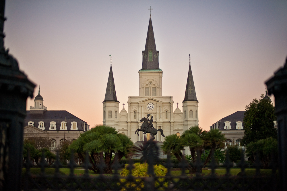 A photograph of Jackson Square at dusk.