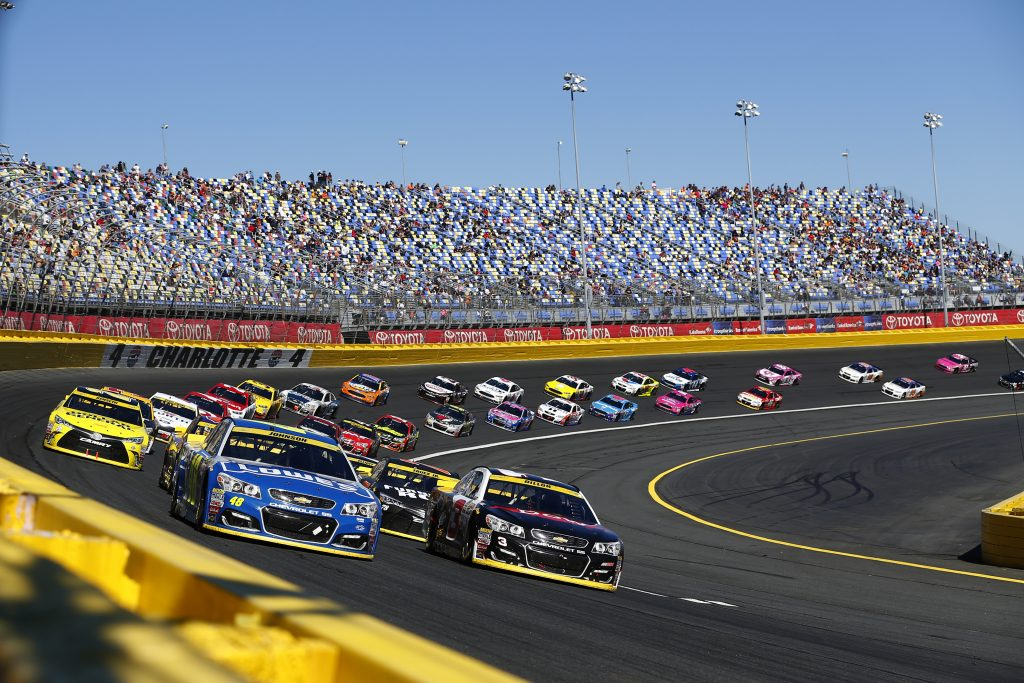 Cars speed along the Charlotte Motor Speedway on a NASCAR North Carolina road trip.