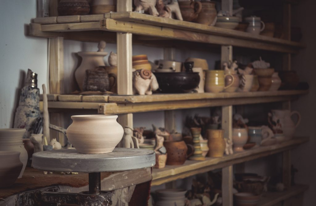 Pottery sits on shelves at the North Carolina Pottery Center.