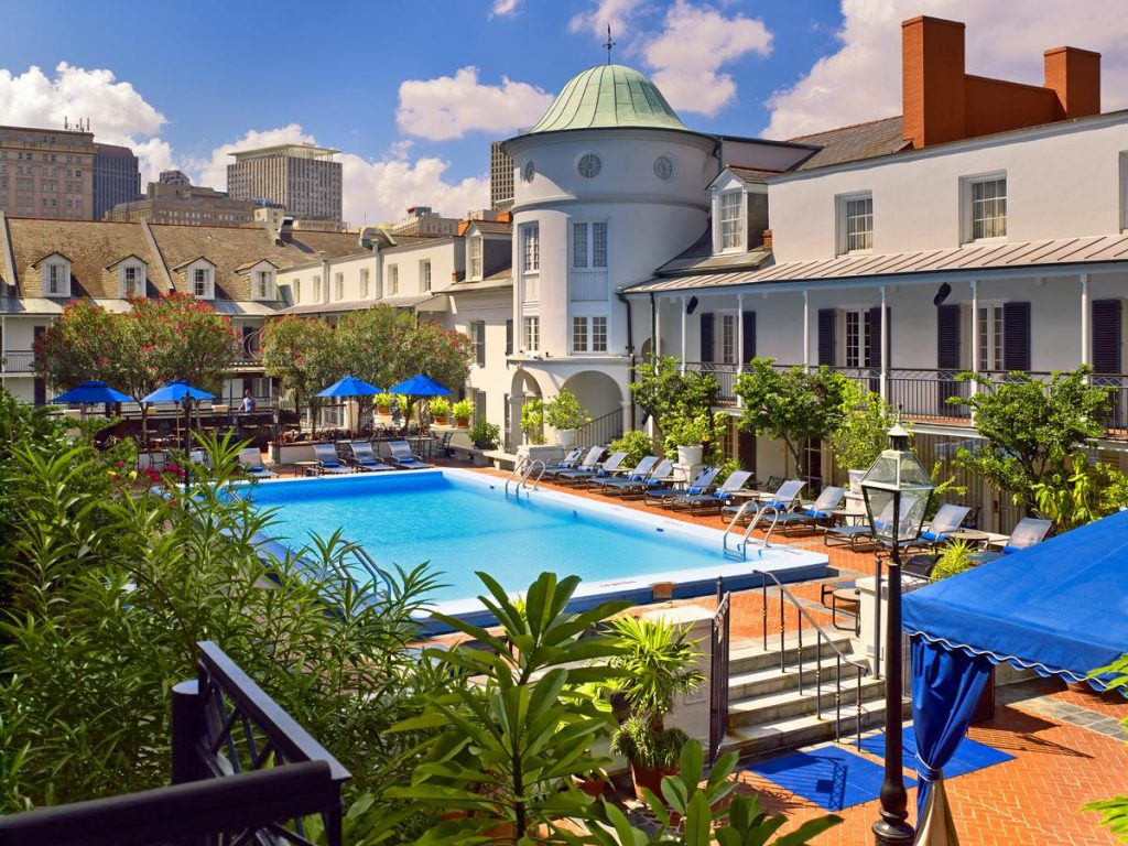 The outdoor pool at the Royal Sonesta hotel in New Orleans one of the best places to stay for a New Orleans Bachelorette Party