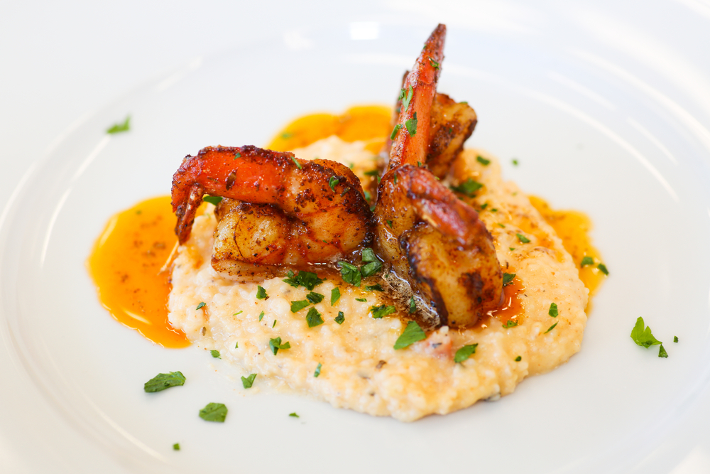 A fancy plating of shrimp and grits
