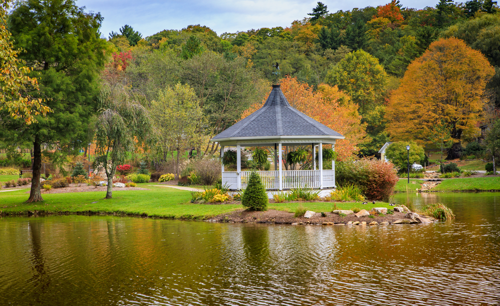 A photo of a quaint gazebo sitting on a lake surrounded by the autumn trees in Blowing Rock, North Carolina.