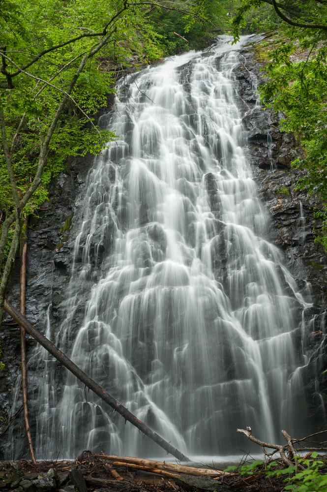 A photo of a massive waterfall on Crabtree Falls Trail, one of the best Blue Ridge Parkway hikes.