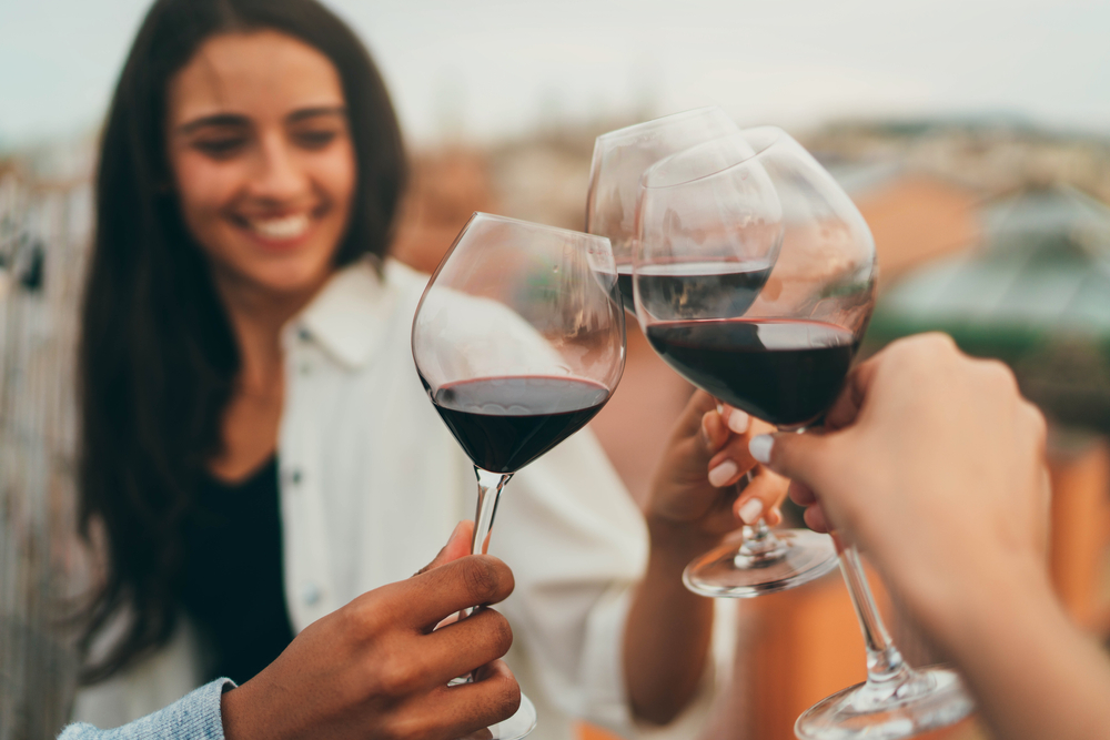A photo of glasses of wine you can enjoy at the best rooftop bars in Savannah.