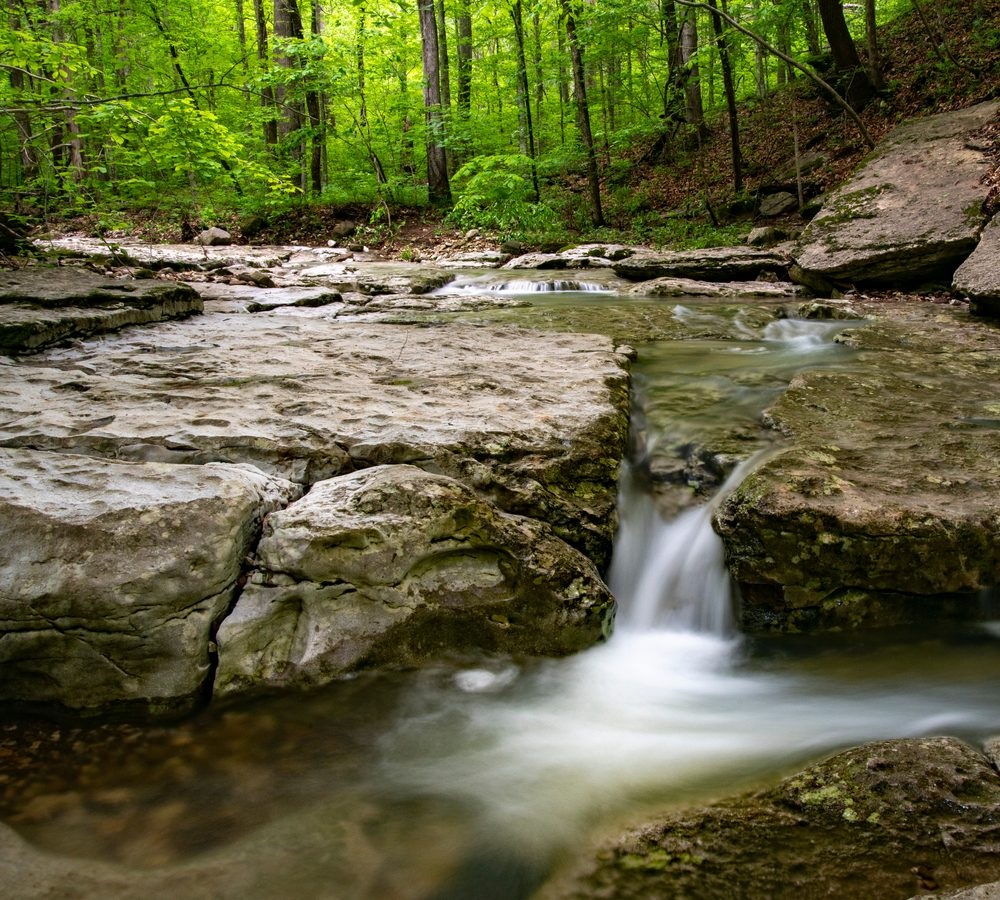 A beautiful waterfall on Lost Valley Trail, one of the most scenic trails in Arkansas