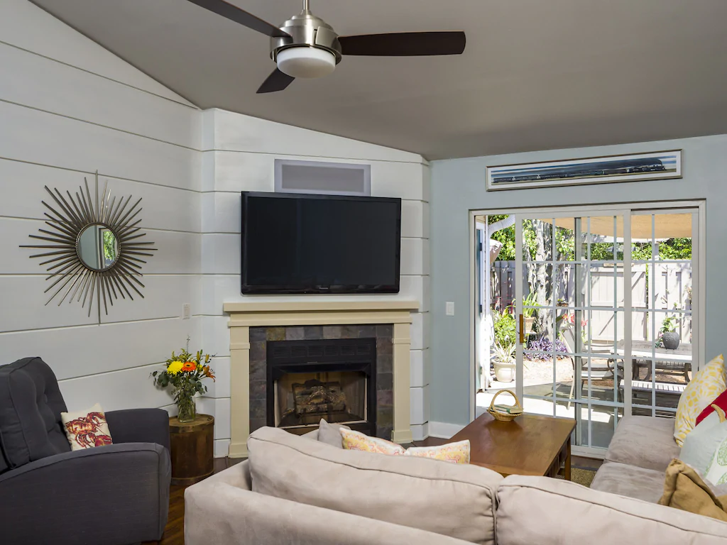 A photo of a living Room with a fireplace in a VRBO in Charleston.