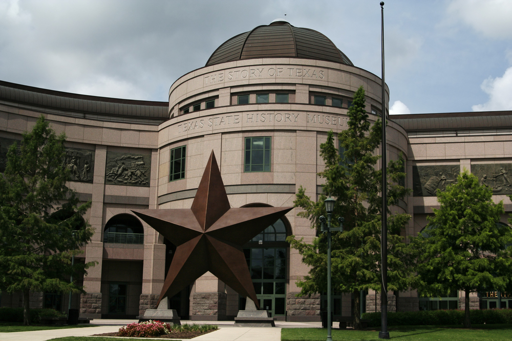 The Texas Star on display at the front of the texas state history museum in texas