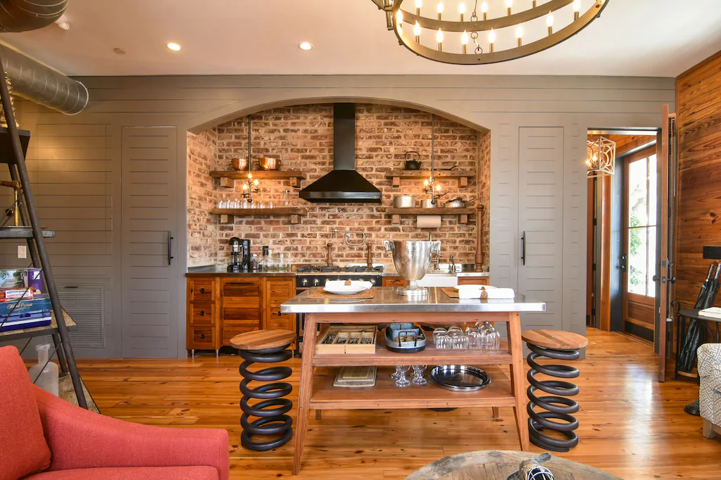 A gorgeous photo of a rustic kitchen in a VRBO in Charleston.