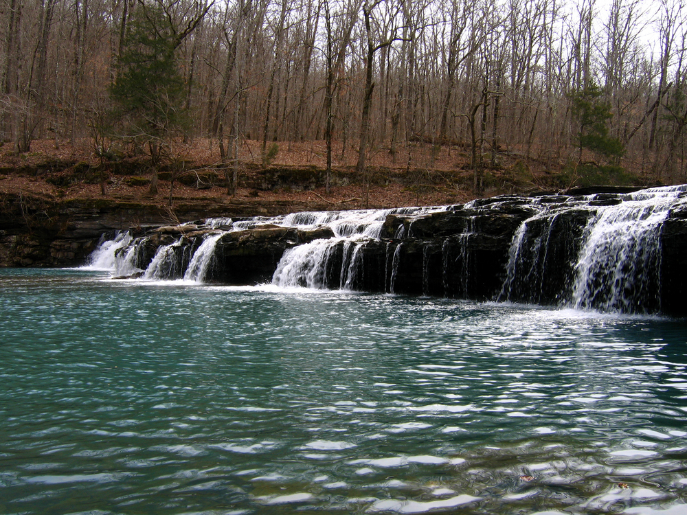 A photo of a waterfall cascading on Richland Creek Campground Trail, one of the best hikes Arkansas.