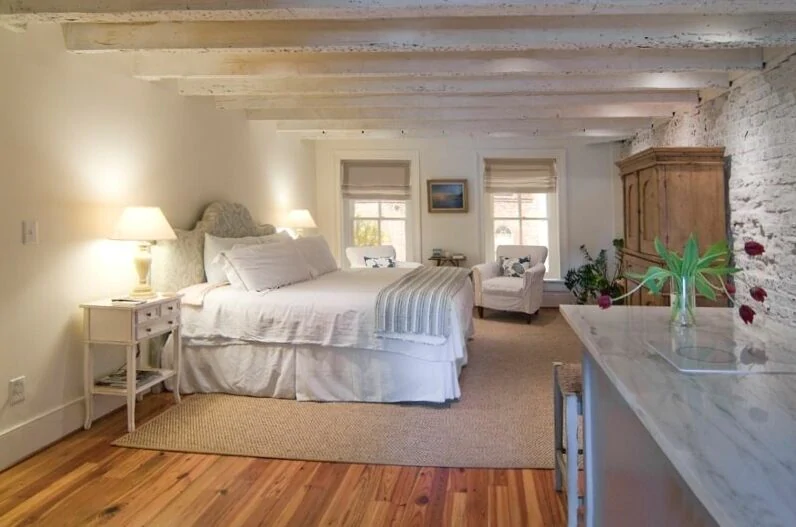 A  beautiful photo of a VRBO in Charleston with exposed white brick.