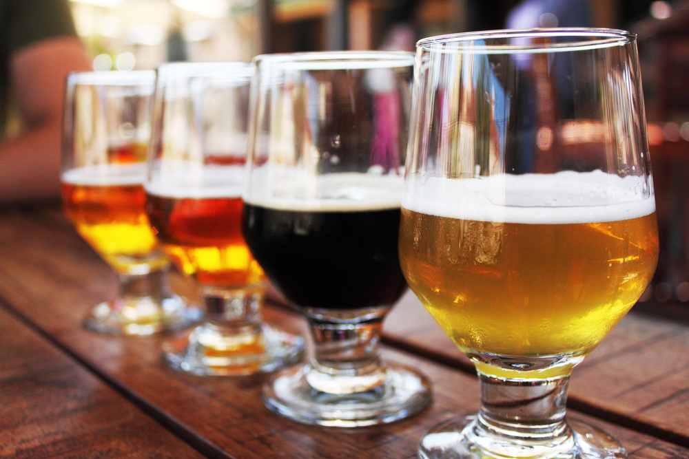 Photo of a beer flight, highlighting Root and Barrel Kitchen.