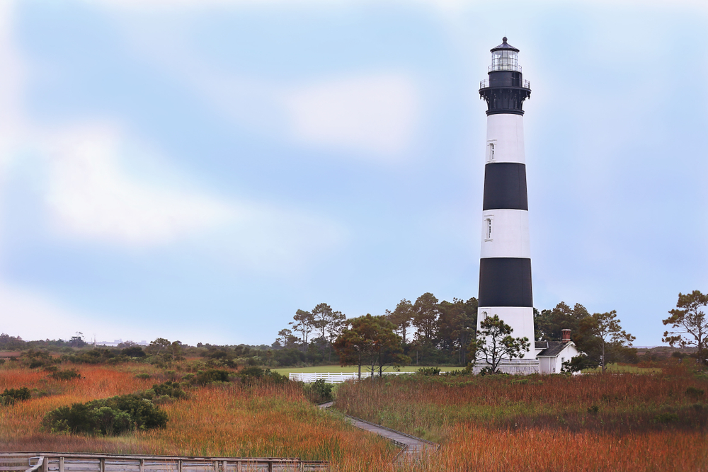 A photo of Bodie Island Lighthouse in the fall located on The Outer Banks of North Carolina.