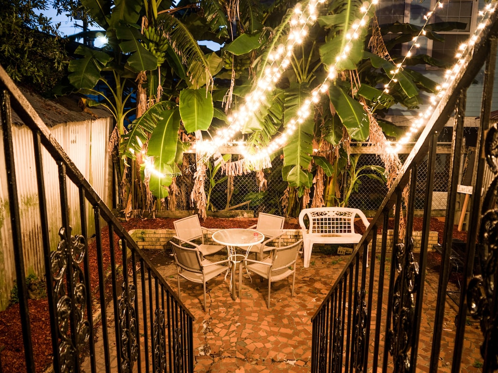 The scenic patio area of this uptown New Orleans VRBO provides the perfect atmosphere to relax