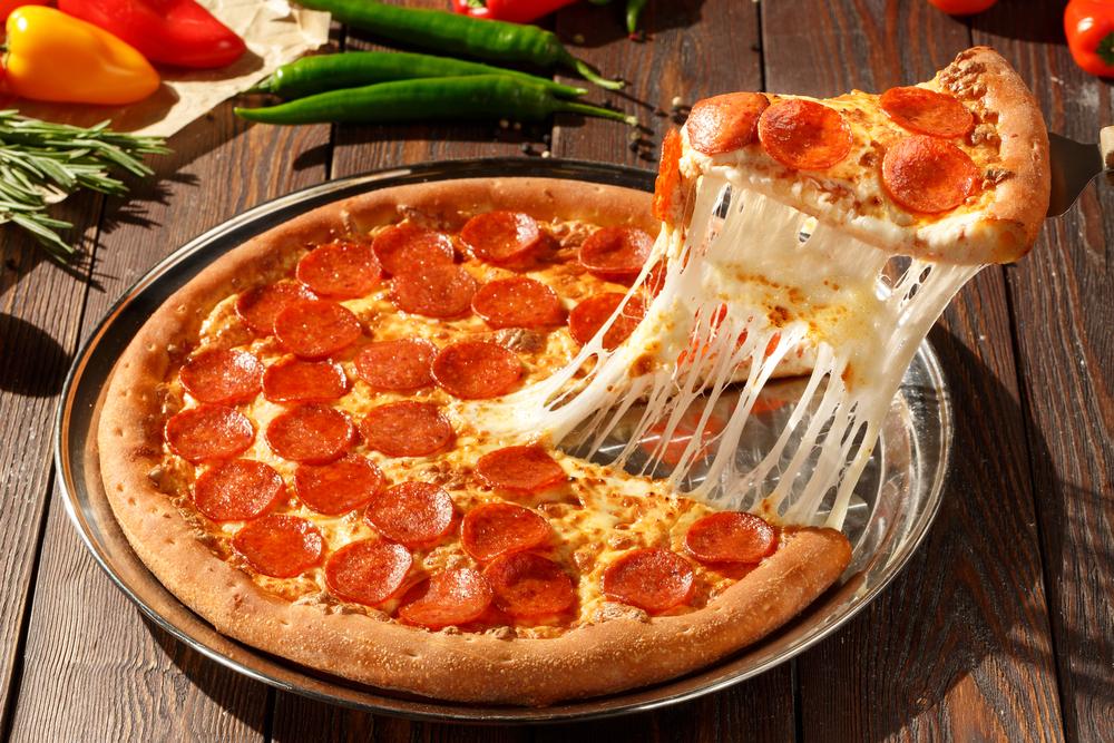 Photo of a pepperoni pizza, highlighting Vito's Pizza & Italian Tavern.