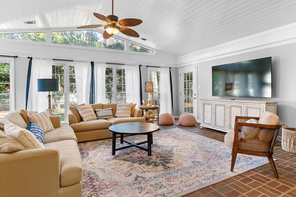 Photo of the living room inside Isle of Hope Charmer, one of the best vacation rentals in Savannah's Moon River District.